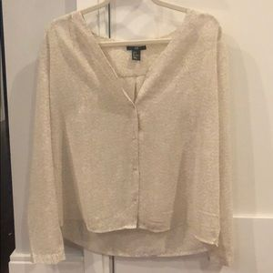 Beige and white patterned long-sleeved shirt.